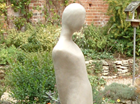 A tall abstracted female figure creating a serene atmosphere. Suitable for a garden setting and is cast in frost proof resin.