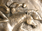 A stylised frost proof plaque for hanging on a wall showing three Race Horses reaching the finishing line. Suitable for the decoration of a stable yard.