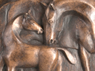 A stylised frost proof plaque for hanging on a wall showing a touching scene of a Mare tending her Foal. Suitable for the decoration of a stable yard.